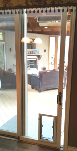 hale pet door brand dog door installed through a sliding glass door